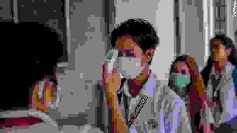 أعراض فيروس كورونا المستجد